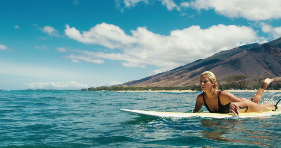 Beautiful Girl Paddling Surfboard Over Blue Ocean Wave