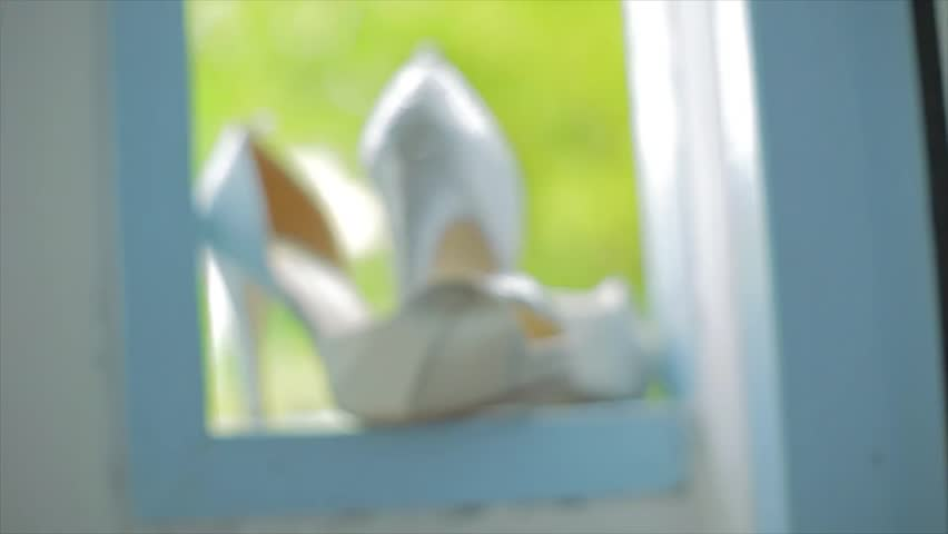 Wedding shoes on the window with nature background.   Shutterstock HD Video #17650915