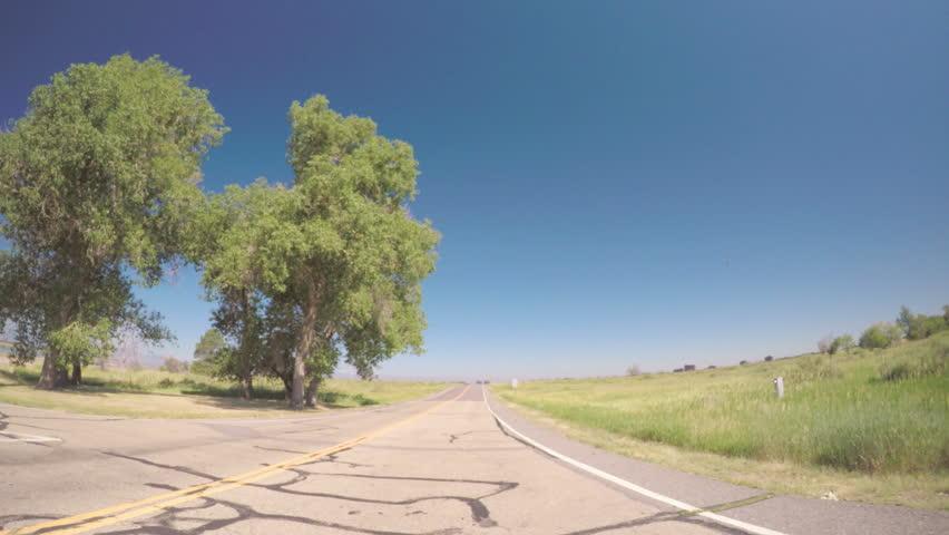 Denver, Colorado, USA-June 27, 2016. Car driving through Cherry Creek State Park-POV point of view. - 4K stock video clip