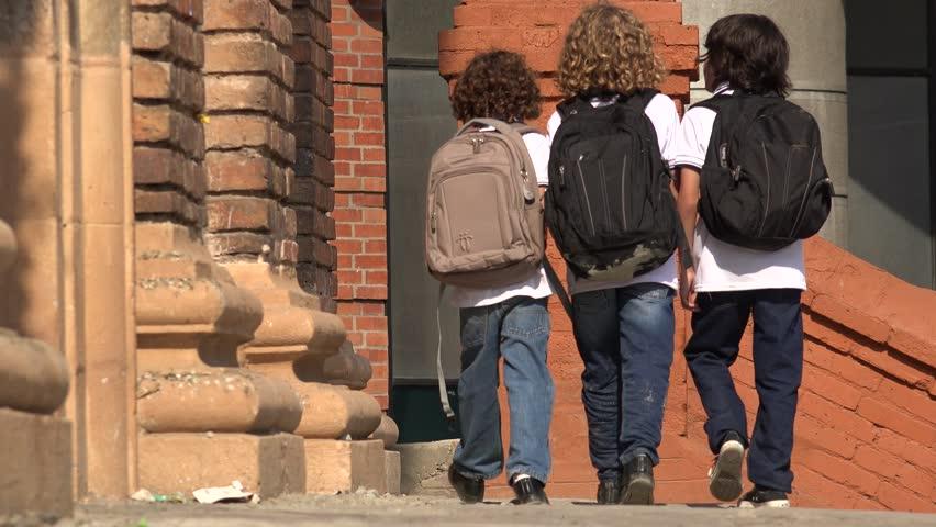 Elementary School Kids Walking With Backpacks