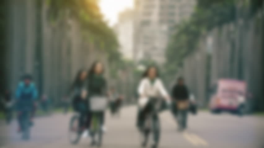 Anonymous Asian students walking in slow motion out of focus. People walking or riding bikes to school or university in Asia in the morning. - 4K stock video clip