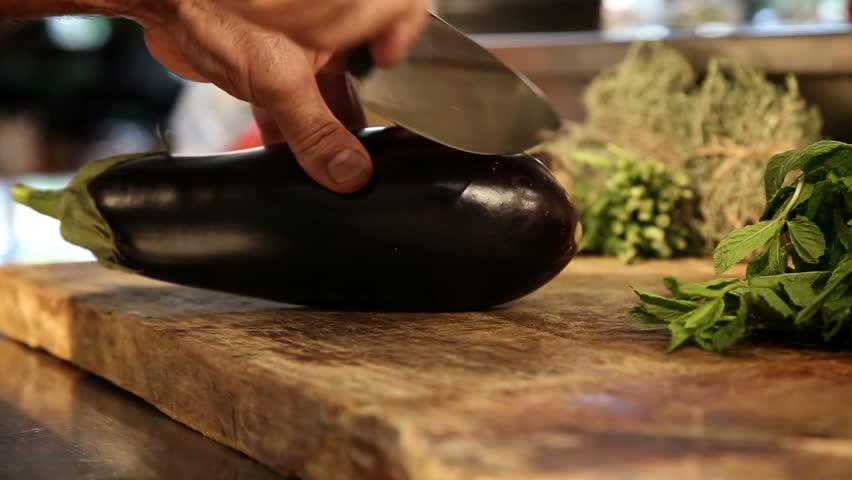 Chief cut an eggplant.