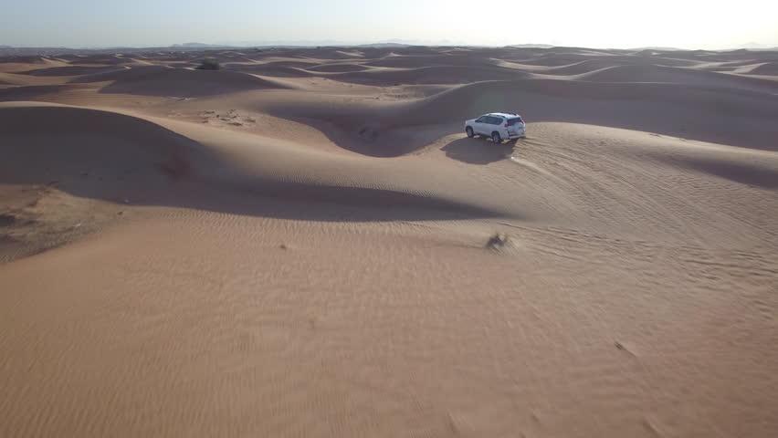 4x4 car in desert - 4K stock footage clip