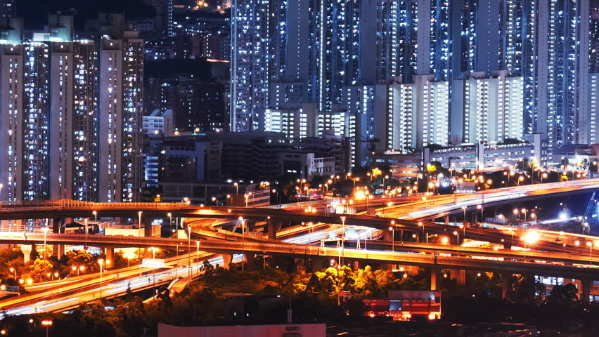 Car lights move fast on elevated highway road. Hong Kong high buildings at night   Shutterstock HD Video #17949166