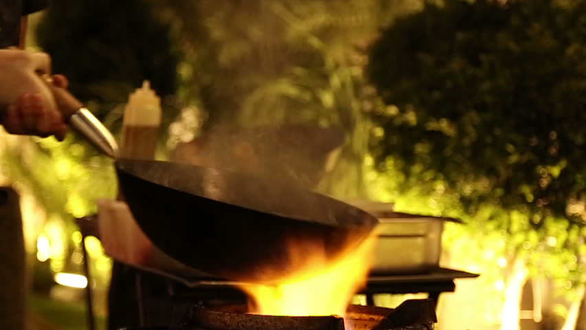 Stir frying and preparing sauteed vegetables in wok on flame, fire. Slow motion. , cook working,
