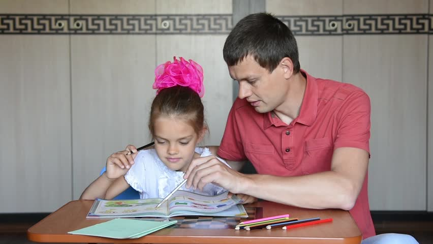 The girl first grader and Dad decide logical problems in the textbook | Shutterstock HD Video #18022462