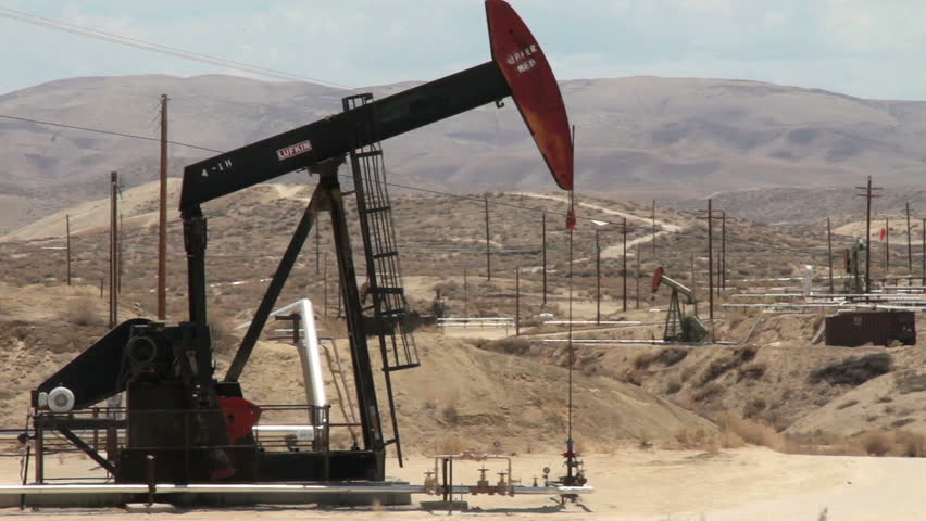 MARICOPA, CALIFORNIA - JULY 2014: Oil well pumps operating in the desert of California to help fuel America's growing need for petroleum products and promote our independence from foreign crude oil. - HD stock footage clip