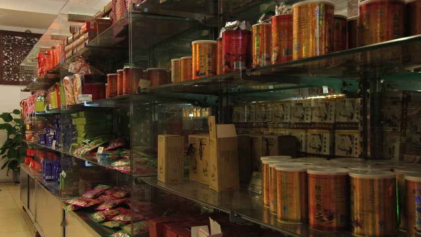BEIJING, CHINA - MAY 26, 2013: View to the tea boxes at the shelves of a tea shop in Beijing, China.  - HD stock footage clip