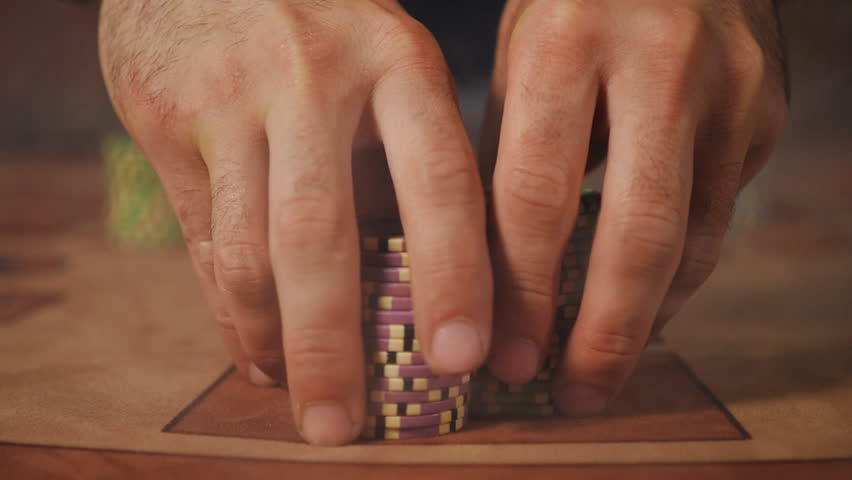 Hands frame - the dealer pushes the player's winnings in a puff of smoke | Shutterstock HD Video #18075967