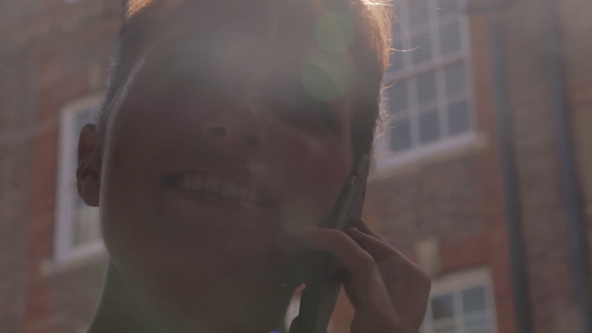 CU LA Young woman using mobile phone outdoors / Soho, London, United Kingdom - HD stock footage clip
