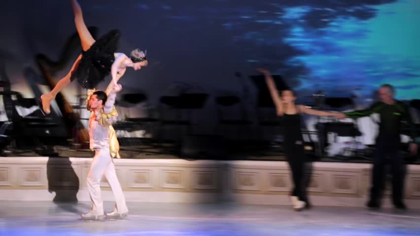 """MOSCOW, RUSSIA - JANUARY 12, 2016: Full rehearsal of theater of ice miniatures perfomance anniversary program """"We are 30"""" under direction of Igor Bobrin. Prince holds black swan above his head"""