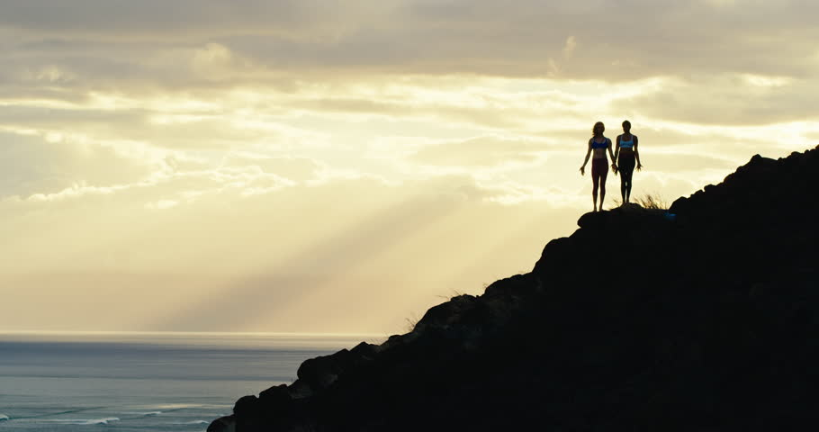 Yoga silhouette of two women at sunset in amazing natural landscape | Shutterstock HD Video #18186370