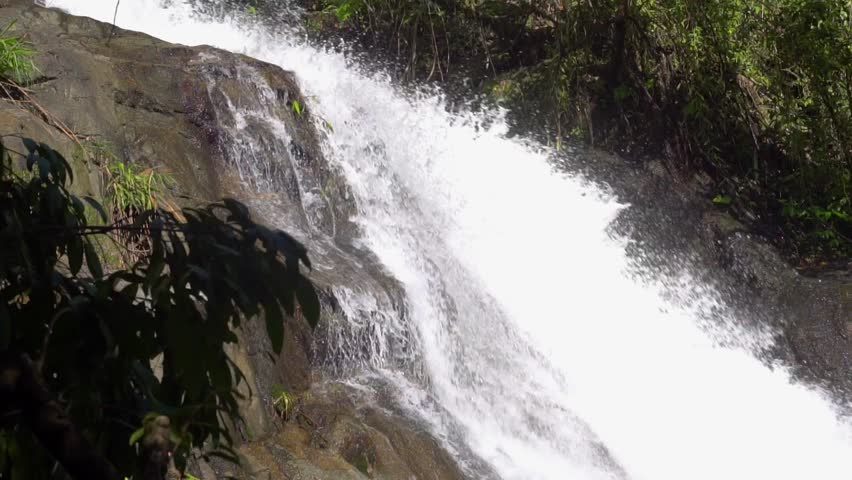 Close approach to waterfall, Phuket. Thailand, South East Asia. Slow motion.