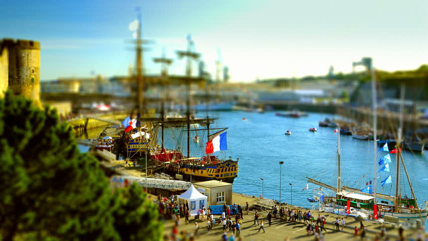 Brest, France - July 14, 2016: Old rigging under the castle in the harbor of Brest with Etoile du Roy and Hermione, the lafayette's ship  - Tilt shift on the Brest's International Maritime Festival.