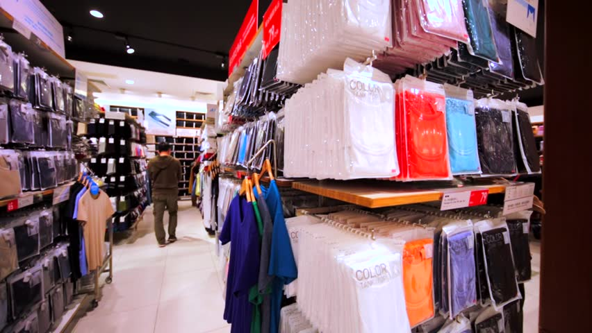 HONG KONG, CHINA - APRIL 2, 2016: 360 panoramic view of the shelves with clothes in Uniqlo store in Hong Kong mall. Japanese casual wear designer of the latest essentials for women, men, kids & babies