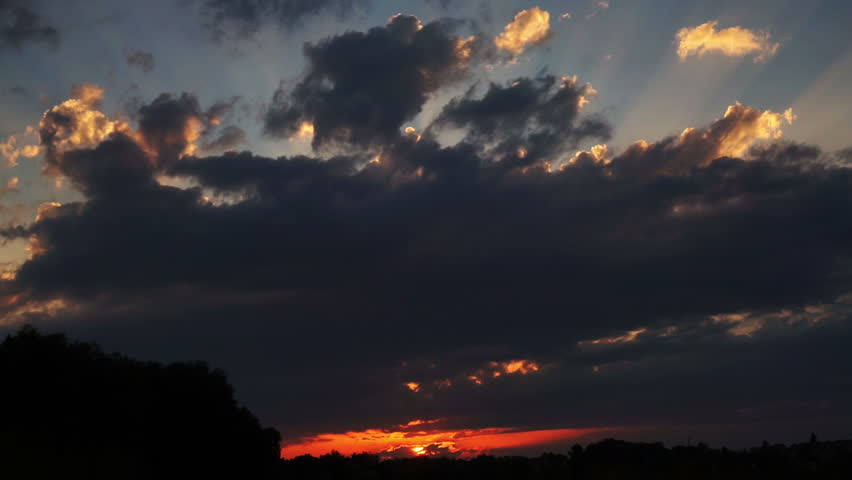 4K. Color clouds on sunset. Time-lapse. - HD stock footage clip