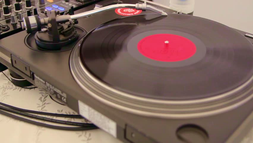 Music device with a vinyl record. Dj. The spinning vinyl record.