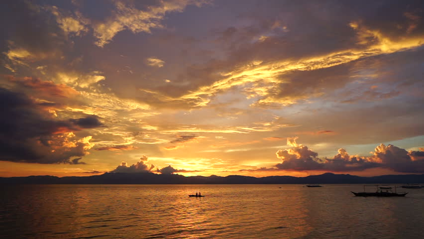 Amazing colorful sunset at the tropical sea with riding philippine boat in Moalboal