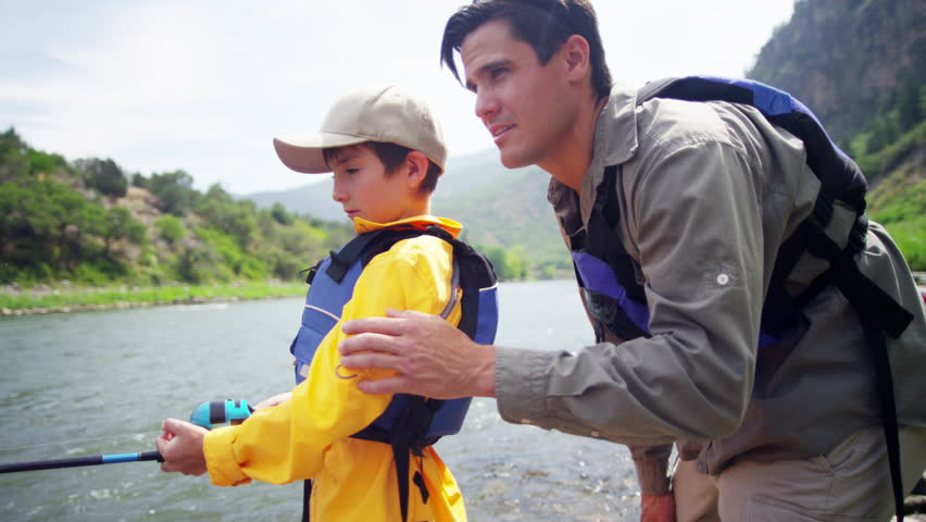 Caucasian father and son having adventure fishing on Colorado River outdoors | Shutterstock HD Video #18305008