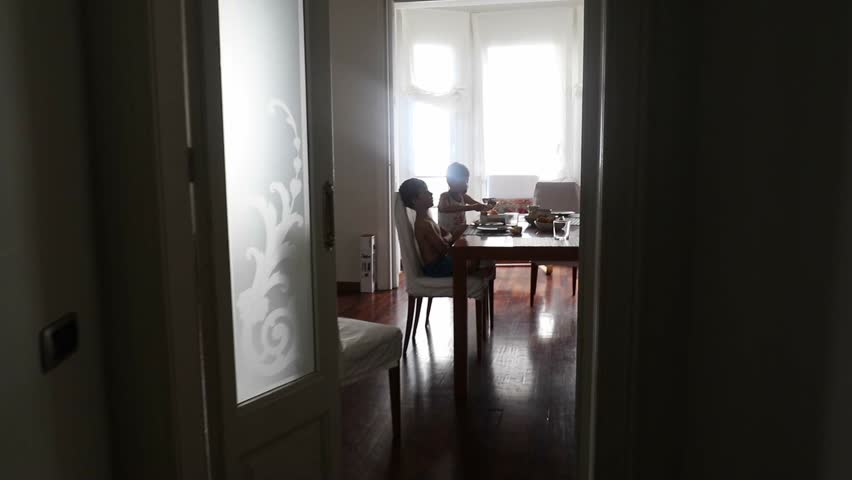 Family eating breakfast together in the morning. Yung boys and mom together eating breakfast. Baby toddler and brothers eating morning breakfast | Shutterstock HD Video #18310390