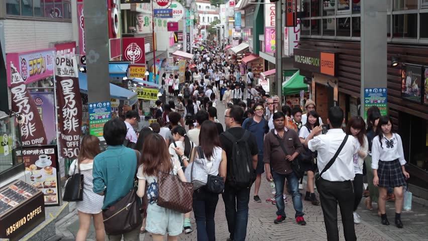 TOKYO, JAPAN - July 14: Anonymous crowds on Takeshita street of Harajuku in Tokyo, Japan on JULY 14, 2016