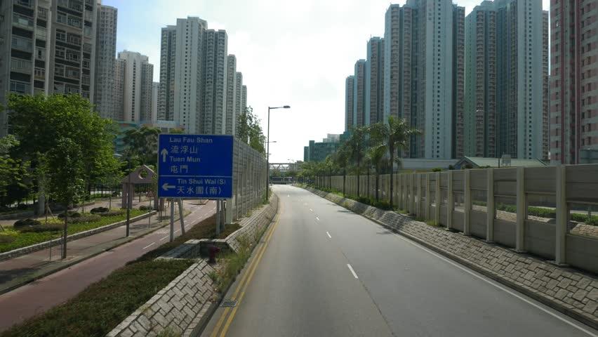 Tin Shui Wai, Hong Kong- July 2016: Driving through city streets time lapse in Hong Kong city