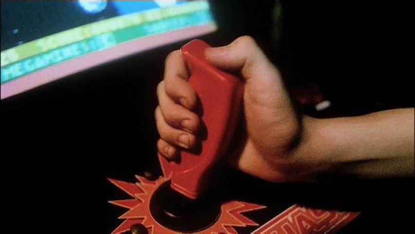 Close-up hand on joystick