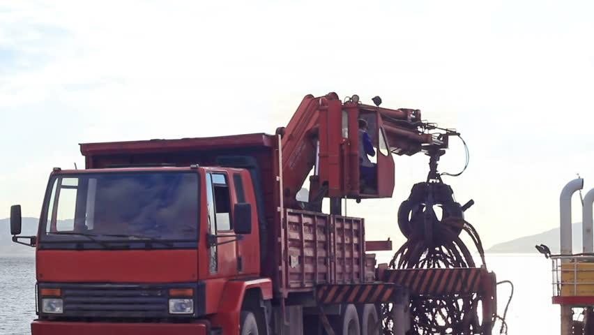 Truck crane lifting up scrap rebars