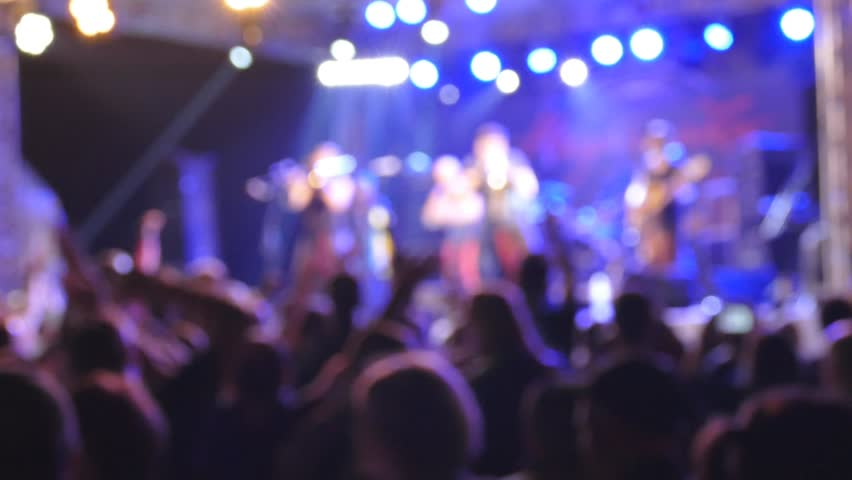 People at the concert. Defocused slow motion - HD stock footage clip