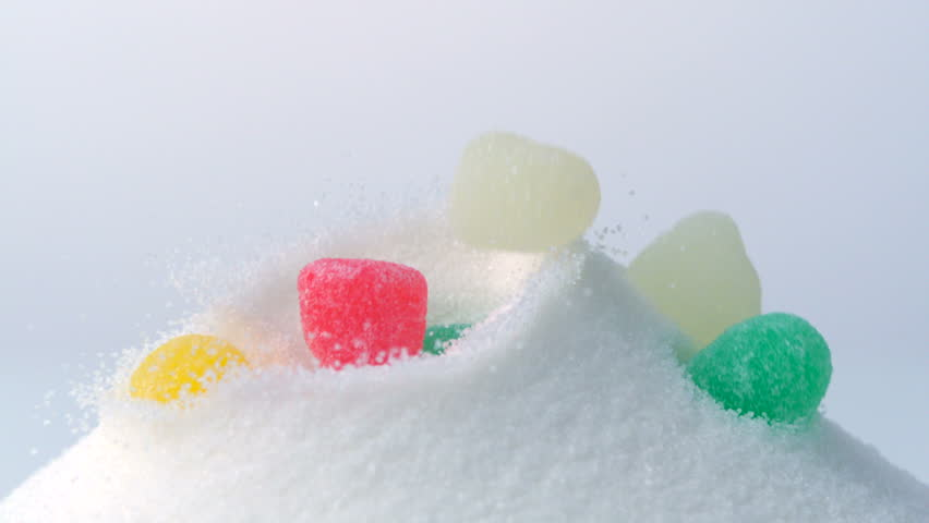 Jelly drops fall atop sugar mound, Slow Motion