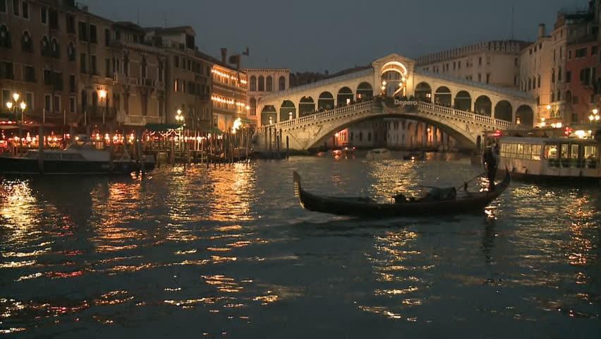 Gondola in front of Rialto Bridge on the Canale Grande in Venice, Italy | Shutterstock HD Video #1892527