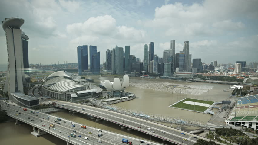 Timelapse Singapore aerial view of the marina bay going down