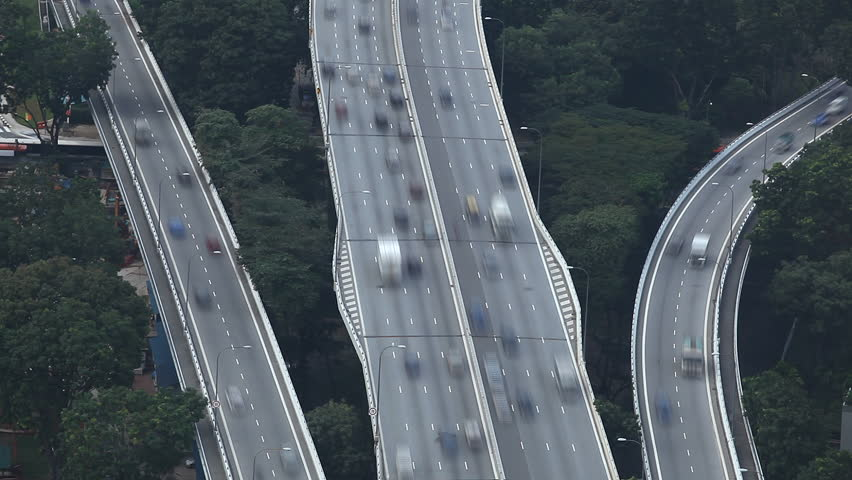 Time Lapse of Aerial View of East Coast PKWY Highway big traffic in Singapore - HD stock footage clip