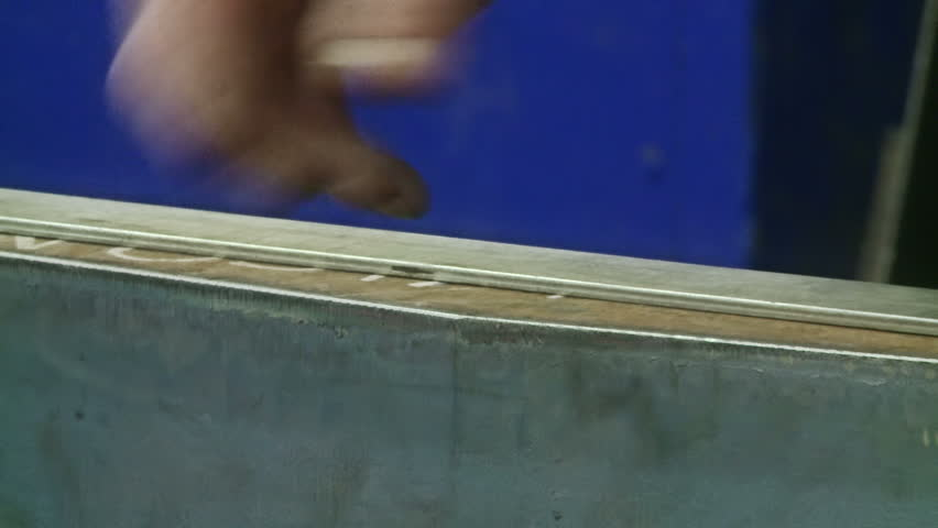 Measurement of metal parts prior to drilling - HD stock footage clip