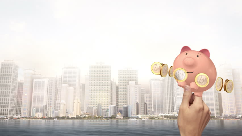 Hand Holding Piggy Bank With Euro Coins - City Scene | Shutterstock HD Video #19081213