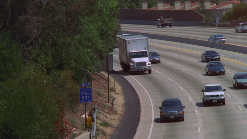Day from overpass down angle ND freeway Los Angeles white truck cam other cars then tilts down silver SUV cam | Shutterstock HD Video #19139785