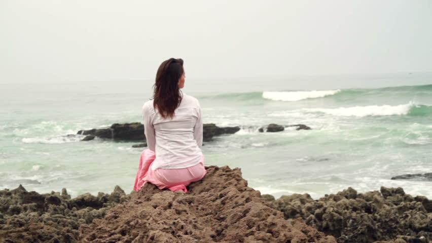 Pensive woman sitting ...