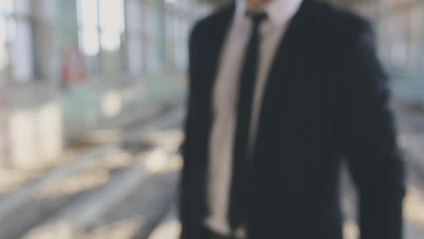 Man in suit aim shotgun | Shutterstock HD Video #19196242