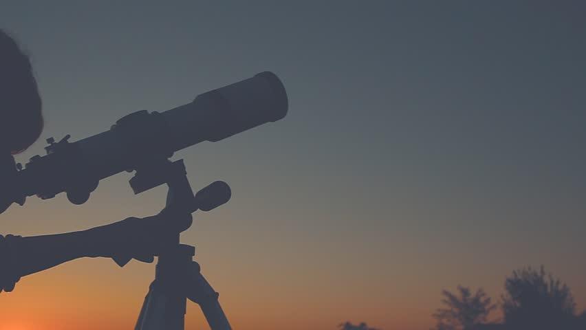 Girl stargazing with a telescope. | Shutterstock HD Video #19222639
