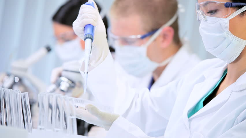 Medical and scientific research assistants working in laboratory conditions | Shutterstock HD Video #1929931