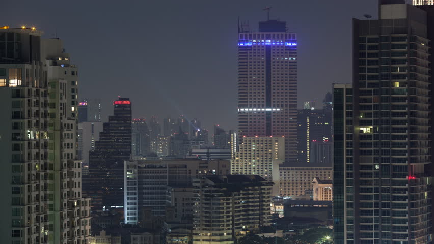 Timelapse shot of blinking windows and city lights of high-rise buildings in night Bangkok, Thailand | Shutterstock HD Video #19393054