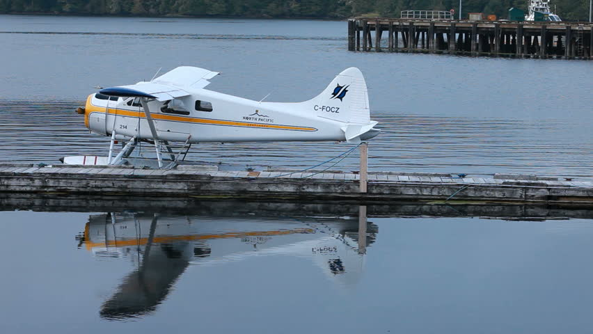 PRINCE RUPERT, BC, CANADA - AUG 10: Float plane moored in marina dock on August 10, 2011 in Prince Rupert, Canada. Main and only mode of transportation in much of Canada and Alaska. - HD stock video clip