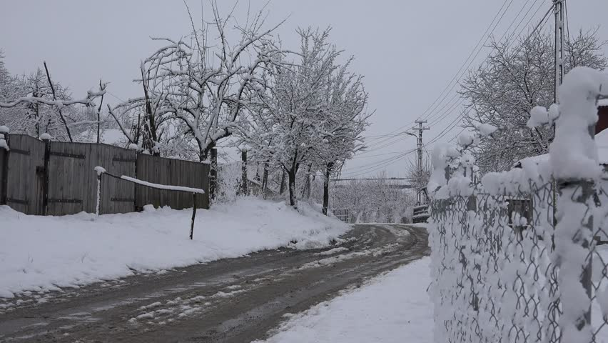 4K Beautiful country car road covered by snow, rural village house in winter day   Shutterstock HD Video #19460230