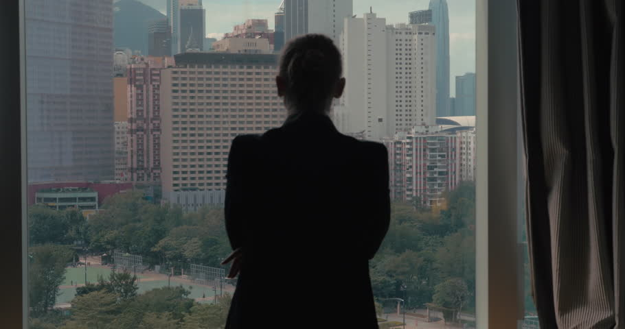 Clip of woman silhouette opening window curtains separately every side on the view of Hong Kong, China   Shutterstock HD Video #19477051