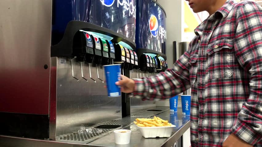 Soft Drink Dispensing From A Soda Fountain Dispenser