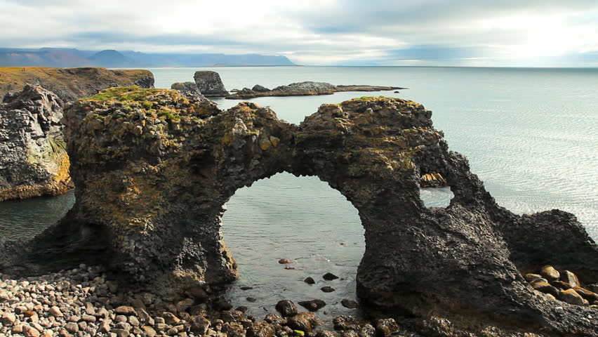 Sea Arches Formed By Ocean Erosion In Arnarstapi, Iceland ...