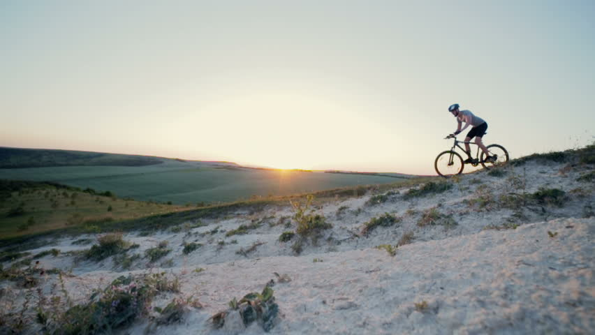 Cyclist riding cross-country through low mountains | Shutterstock HD Video #19515994