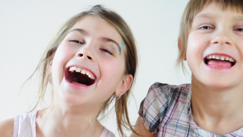 Two happy playful children laughing and making faces - HD stock video clip
