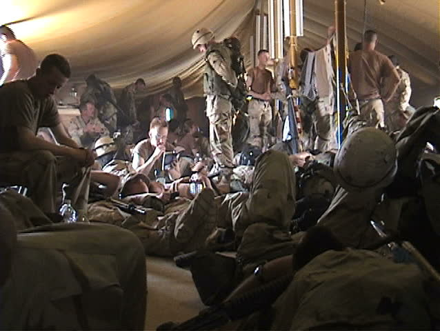 IRAQ - CIRCA 4/7-4/13/03: U.S. Soldiers suffering from heat exhaustion. - SD stock video clip
