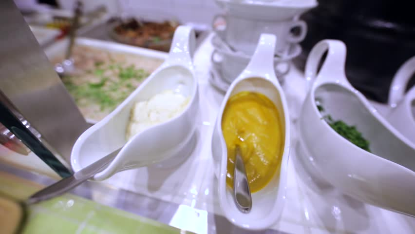 "Closeup view of a few types of sauce, chopped parsley and dill in ""Chaban House"" restaurant in Moscow, Russia. #19726846"